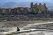 A refugee child who lives with her family (originally from the north) in nearby ruins, plays in the rubble in the Darolaman area of Kabul. The area was destroyed in the Afghan civil War of the late 1980's and early 1990's by militias loyal to different Afghan warlords.