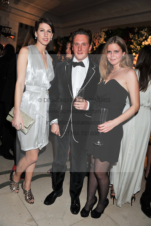 Left to right, SUSANNA WARREN, HARRY BECHER and KATIE READMAN at a dinner and dance hosted by Leon Max for the charity Too Many Women in support of Breakthrough Breast Cancer held at Claridges, Brook Street, London on 1st December 2011.