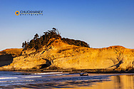 Fishing Dory Boat heads out at sunrise at Cape Kiwanda in Pacific City, Oregon, USA