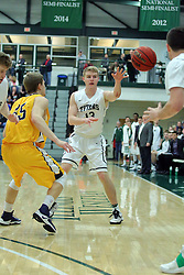 21 February 2017:  Brady Rose passes off to get past defender Jacob Johnston during an College men's division 3 CCIW basketball game between the Augustana Vikings and the Illinois Wesleyan Titans in Shirk Center, Bloomington IL