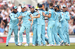 England's Ben Stokes (centre left) celebrates after South Africa's Dwaine Pretorius is run out with team-mates during the ICC Cricket World Cup group stage match at The Oval, London.