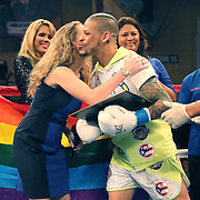 KISSIMMEE, FL - JULY 15: Orlando Cruz receives an award from Dina Grayson for his efforts to help the gay community, prior to his fight against Alejandro Valdez at the Kissimmee Civic Center on July 15, 2016 in Kissimmee, Florida. Cruz was the first professional boxer to announce himself as gay and recently lost four friends in the Pulse Nightclub shooting in Orlando, he dedicated this match to his lost friends and won the bout by TKO in the 7th round.  (Photo by Alex Menendez/Getty Images) *** Local Caption *** Orlando Cruz; Dina Grayson
