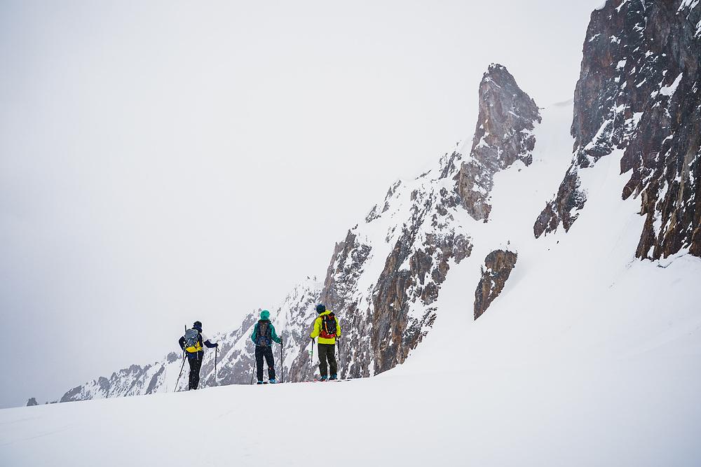 Darcy Conover, Jenny Harris, and Adam Moszynski stand below Big Fatty, Marshall Basin, Sawtooth Range, Idaho.