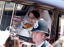 Meghan Markle drives down The Long Walk towards Windsor Castle with her mother Doria Ragland for her royal wedding ceremony to Britain's Prince Harry at St George's Chapel in Windsor Castle, in Windsor, Britain, 19 May 2018. Photo by Lauren Hurley / ABACAPRESS.COM