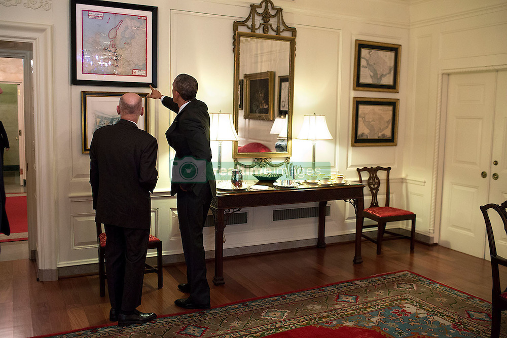President Barack Obama talks with President Ashraf Ghani of Afghanistan in the Map Room following a working lunch in the Old Family Dining Room of the White House, March 24, 2015. (Official White House Photo by Pete Souza)<br /> <br /> This official White House photograph is being made available only for publication by news organizations and/or for personal use printing by the subject(s) of the photograph. The photograph may not be manipulated in any way and may not be used in commercial or political materials, advertisements, emails, products, promotions that in any way suggests approval or endorsement of the President, the First Family, or the White House.