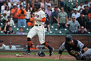 San Francisco Giants right fielder Hunter Pence (8) scores a run against the Colorado Rockies at AT&T Park in San Francisco, California, on September 20, 2017. (Stan Olszewski/Special to S.F. Examiner)