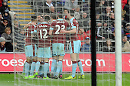 Burnley players celebrate  their second goal scored by Andre Gray (in huddle). Premier league match, Swansea city v Burnley at the Liberty Stadium in Swansea, South Wales on Saturday 4th March 2017.<br /> pic by  Carl Robertson, Andrew Orchard sports photography.
