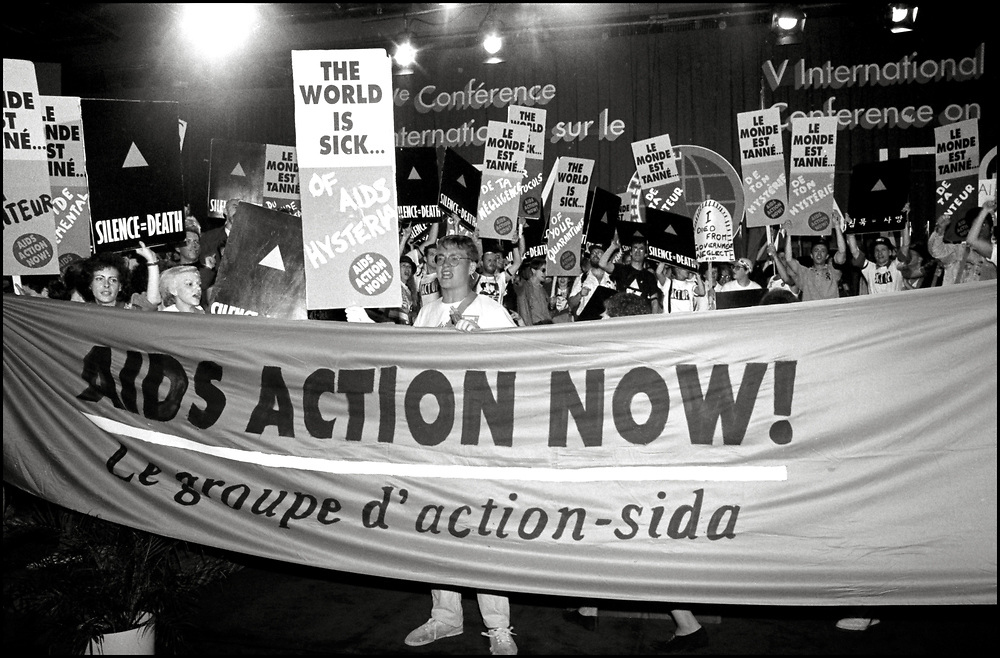 ACT UP New York takes the stage at the opening ceremonies of the Fifth International AIDS Conference in Montreal on June 4, 1989.<br /> <br /> ACT UP NY stormed the Fifth International AIDS Conference in Montreal, at the time a members-only event for doctors and HIV/AIDS researchers. They took over seats reserved for dignitaries, and released their first Treatment and Data report calling for speedier access to AIDS drugs.