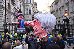 "© Licensed to London News Pictures. 23/03/2019. LONDON, UK.  A caricature of Theresa May outside Downing Street after people took part in the ""Put It To The People March"", on what was supposed to be six days before the UK was due to leave the EU, before an extension to the departure date was given.  Protesters demand that the public is given a final say on Brexit as support for the Prime Minister's withdrawal plan continues to recede.  Photo credit: Stephen Chung/LNP"