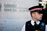 "Police protect the London Stock Exchange at Occupy London protest, October 15th 2011. Protest spreads from the US with this demonstrations in London and other cities worldwide. The 'Occupy' movement is spreading via social media. After four weeks of focus on the Wall Street protest, the campaign against the global banking industry started in the UK this weekend, with the biggest event aiming to ""occupy"" the London Stock Exchange. The protests have been organised on social media pages that between them have picked up more than 15,000 followers. Campaigners gathered outside  at midday before marching the short distance to Paternoster Square, home of the Stock Exchange and other banks.It is one of a series of events planned around the UK as part of a global day of action, with 800-plus protests promised so far worldwide.Paternoster Square is a private development, giving police more powers to not allow protesters or activists inside."