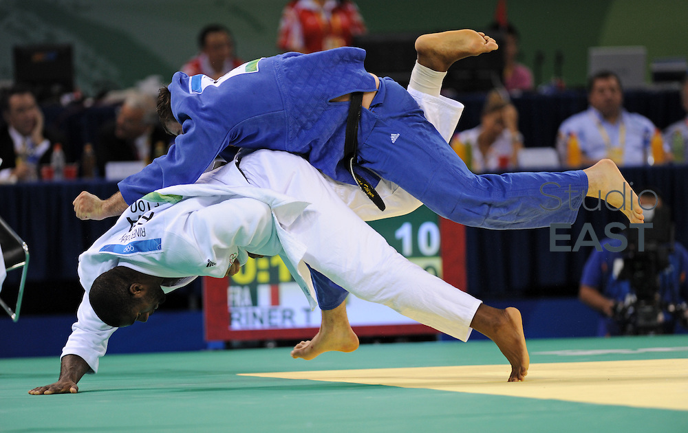 France's Teddy Riner (in white) fights Germany's Andreas Tolzer (in blue) during their men's +100 kgs judo match of the 2008 Beijing Olympic Games on August 15, 2008 in Beijing.. Photo by Lucas Schifres/Pictobank/Cameleon/ABACAPRESS.COM