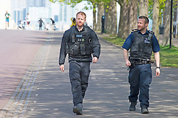 ©Licensed to London News Pictures 04/04/2020  <br /> Greenwich, UK. Police on patrol in the park. People get out of the house from Coronavirus lockdown to exercise and enjoy the mini heatwave weather in Greenwich park,Greenwich, London. Photo credit:Grant Falvey/LNP