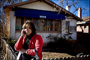 """Crying and clutching the letter denying her application for permanent residency in the United States, Lupita Hernandez phones a friend from outside her lawyer's office in Albuquerque. """"I'm not sure what my future will be, Hernandez said that day in February. ..---------------------..STORY SUMMARY : Lupita Hernandez's lawyer had summoned her to Albuquerque to deliver the bad news in person: Her application to become a legal U.S. resident had been denied. In an instant, with three pieces of paper, the life Lupita Hernandez had built in Santa Fe over 11 years began to wobble. She no longer had the legal right to stay with the family she has created. She no longer felt free to take her two U.S.-born, American-citizen children to school or the doctor. She began to worry her family might be torn apart every time someone knocked on her door. """"The whole world fell on top of me,"""" the 42-year-old says of that day in February. """"I'm in no man's land."""".."""