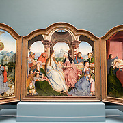 An early 16th century triptych by Quinten Metsys (165/66-1530) titled Triptyque de la Confrerie de Sainte-Anne A Louvain (dated 1509) on display at the Royal Museums of Fine Arts in Belgium (in French, Musées royaux des Beaux-Arts de Belgique), one of the most famous museums in Belgium. The complex consists of several museums, including Ancient Art Museum (XV - XVII century), the Modern Art Museum (XIX ­ XX century), the Wiertz Museum, the Meunier Museum and the Museé Magritte Museum.