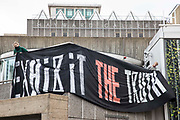 Anti-HS2 activists drop a banner reading Exhibit The Truth during a HS2 Chainsaw Massacre protest outside the Among The Trees exhibition at the Hayward Gallery on 30 October 2020 in London, United Kingdom. The protest, during which the activists were dressed as HS2 enforcement agents and workers, was intended to highlight both the daily environmental destruction being wrought for the controversial HS2 high-speed rail project and instances of violence and brutality by security guards and bailiffs working on behalf of HS2 Ltd.