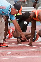 Samsung Diamond League adidas Grand Prix track & field; men's 100 meters, official checks hand position at start