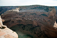 """Next to Canyon de Chelly in Chinle, Arizona, is Canyon del Muerto (Canyon of death).  At some point in time, in our illustrious history, the cavalry went in and wiped out a peaceful tribe of cliff-dwelling indians.  You can see the structures in the center left of the image.    20"""" x 13"""".  Printed on Parrot Digigraphic Ultra Lustre Photopaper.  Limited Editon of 25 (sold only with Face in Canyon del Muerto)."""