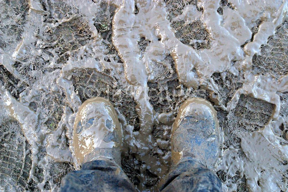 Muddy boots at Glastonbury festival.