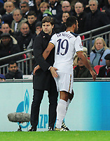 Football - 2016 / 2017 UEFA Champions League - Group E: Tottenham Hotspur vs. Bayer Leverkusen<br /> <br /> Tottenham manager consoles Mousa Dembele as he comes off injured in the first half at Wembley.<br /> <br /> COLORSPORT/ANDREW COWIE
