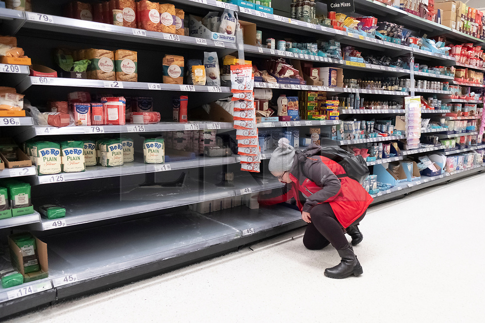 © Licensed to London News Pictures. 03/03/2020. London, UK. A shopper looks for baking flour in an almost empty shelves in a Asda supermarket in Wembley as more Coronavirus disease cases are reported in the the UK. Photo credit: London News Pictures
