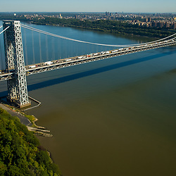 Aerial view of the George Washington Bridge during rush hour. View North East towards Manhattan from New Jersey.  Hudson River in middle.