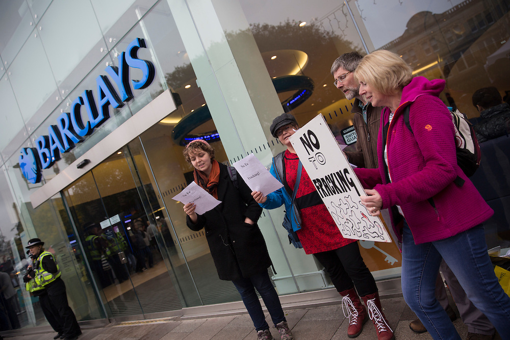 Protesters from Friends of the Earth Cymru outside Barclays Bank, Cardiff city centre during a week of action highlighting Barclay's ownership of fracking company Third Energy. Fracking can cause earthquakes, pollution of water and other environmental problems