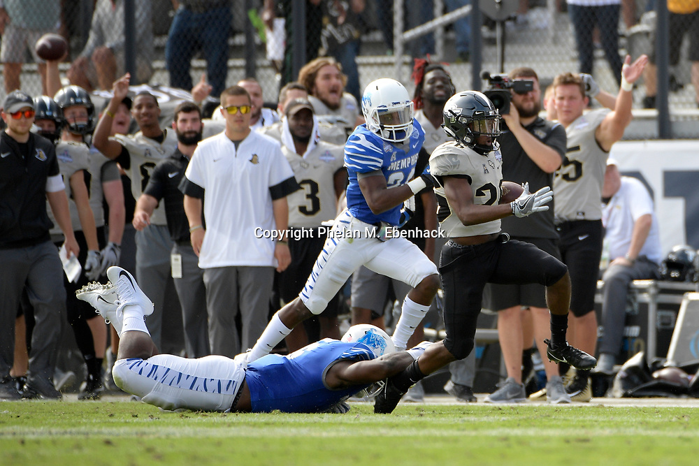 Central Florida wide receiver Otis Anderson (26) runs in front of Memphis linebacker Genard Avery (6) during the first half of the American Athletic Conference championship NCAA college football game Saturday, Dec. 2, 2017, in Orlando, Fla. (Photo by Phelan M. Ebenhack)