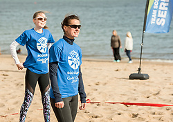 Today marks one year to go before the next Commonwealth Games get underway in Gold Coast, Australia. Athletes from a number of sports joined Scottish Beach Volleyball players, including top duo Lynne Beattie and Mel Coutts, on the new permanent courts on Portobello Beach this morning. The athletes joined with children from Towerbank Primary School to try out the game in the Portobello sunshine.   Pictured: Mel Coutts (foreground) and Seonaid McIntosh<br /> <br /> <br /> © Jon Davey/ EEm