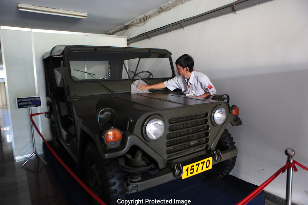 A worker dusts the presidential jeep at the Presidential Palace, now renamed to be called the Reunification Palace, in Saigon now, Ho Chi Minh City.  Photograph by Dennis Brack
