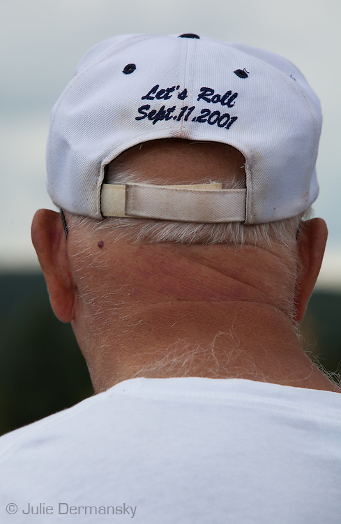 """Man with a """"Let's Roll"""" baseball hat visiting the Flight 93 National Memorial site's temporary memorial  that overlooks the field where the flight crashed in Shanksville Pennsylvania. The temporary site will close on Sept. 9th at 4 P.M. and on Sept. 10 the official memorial will open in time for the 10th anniversary of 9/11"""