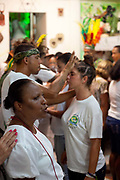 Adherants are cleansed by the Babalawos conducting the ceremony,  Terreiro (yard) peace and love / Terreiro Paz y Amor, Salvador, Bahia, Brazil. Often the lines between Candomble, Catholicism and Umbanda are blurred. Salvador de Bahia is seen as the home of Candomble.