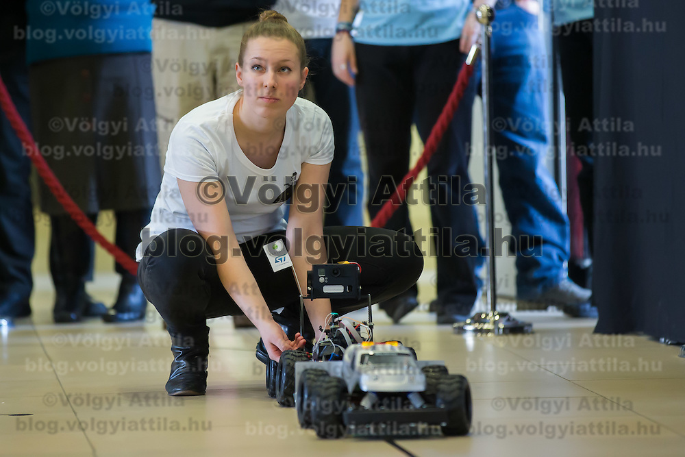 Competitor adjusts her car during the RobonAut technical university race for self driving autonomous cars in Budapest, Hungary on January 10, 2015. ATTILA VOLGYI