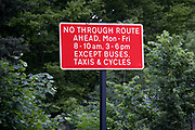 The signpost at the junction of the South Circular A205 and College Road in Dulwich Village, warning motorists of the restrictions preventing traffic from passing through at morning and afternoon rush-hour times in the borough of Southwark, on 15th June 2021, in London, England.