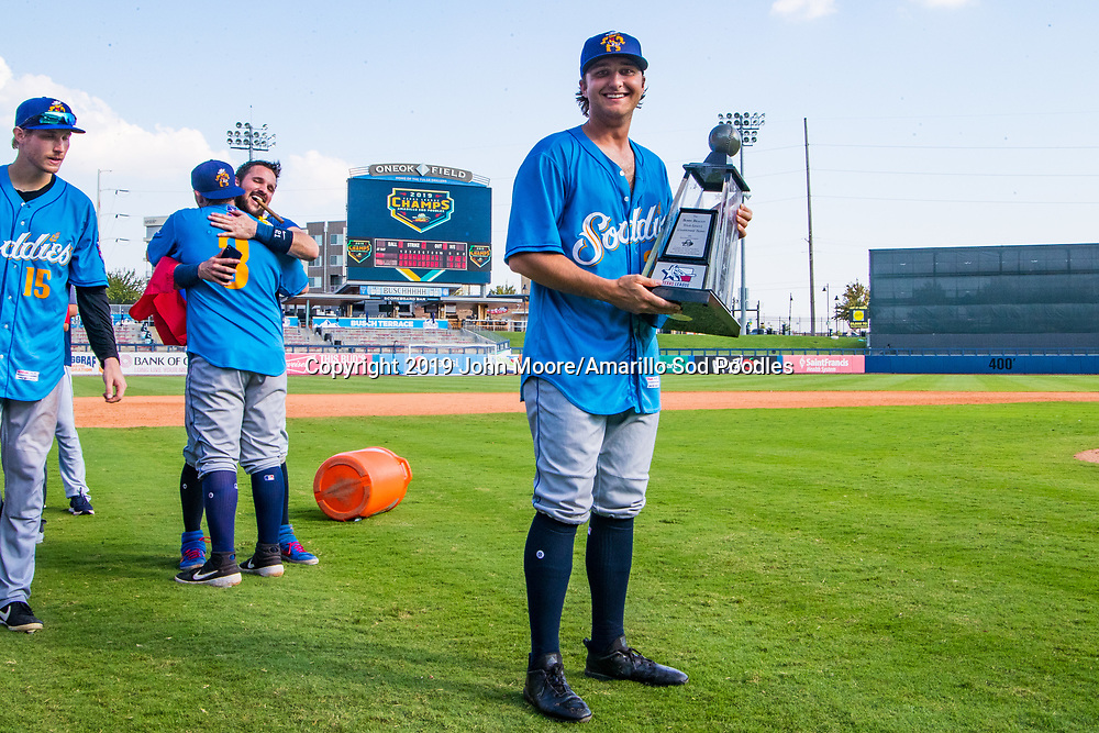 Amarillo Sod Poodles pitcher Sam Williams (20) poses with the trophy after the Sod Poodles won against the Tulsa Drillers during the Texas League Championship on Sunday, Sept. 15, 2019, at OneOK Field in Tulsa, Oklahoma. [Photo by John Moore/Amarillo Sod Poodles]