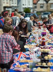 © Licensed to London News Pictures. 04/06/12.Saltburn, England...A street party is held to celebrate the Queen's Diamond Jubilee on Irvin Avenue in Saltburn by the Sea in Cleveland.. .The Royal Jubilee celebrations. Great Britain is celebrating the 60th  anniversary of the countries Monarch HRH Queen Elizabeth II accession to the throne this weekend Photo credit : Ian Forsyth/LNP