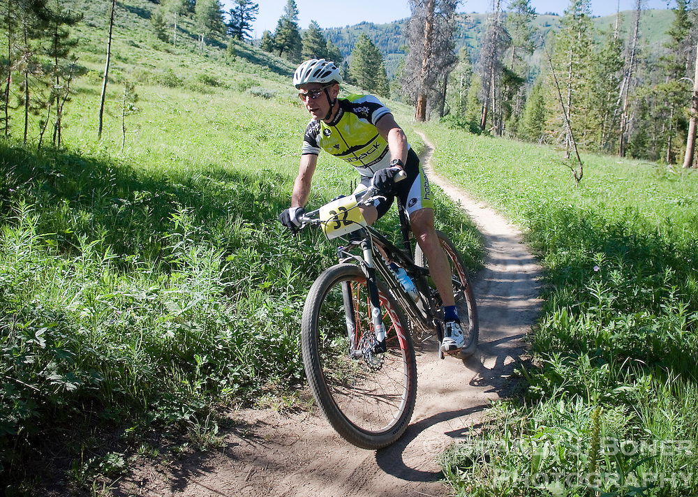 Cary Smith cruises over the divide between Cache Creek and Game Creek to a first-place finish in the Cache/Game mountain bike race July 27. Cary also set a new course record with a time of 39:52.