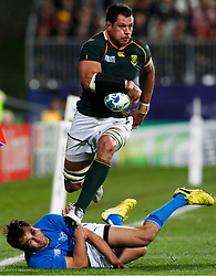 South Africa Springboks' Pierre Spies avoids the tackle of Namibia's Danie Van Wyk (on ground) during their Rugby World Cup Pool D match at North Harbour Stadium in Auckland September 22, 2011. REUTERS/Nigel Marple (NEW ZEALAND  - Tags: SPORT RUGBY)