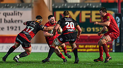 Scarlets' Wyn Jones is tackled by Dragons' Thomas Davies<br /> <br /> Photographer Craig Thomas/Replay Images<br /> <br /> Guinness PRO14 Round 13 - Scarlets v Dragons - Friday 5th January 2018 - Parc Y Scarlets - Llanelli<br /> <br /> World Copyright © Replay Images . All rights reserved. info@replayimages.co.uk - http://replayimages.co.uk