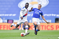 LEICESTER, ENGLAND - JULY 04: Christian Benteke of Crystal Palace is challenged by Ryan Bennett of Leicester City during the Premier League match between Leicester City and Crystal Palace at The King Power Stadium on July 4, 2020 in Leicester, United Kingdom. Football Stadiums around Europe remain empty due to the Coronavirus Pandemic as Government social distancing laws prohibit fans inside venues resulting in all fixtures being played behind closed doors. (Photo by MB Media)