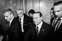 """ROME, ITALY - 24 JANUARY 2013: Silvio Berlusconi, former PM and leader of The People of Freedom party, steps outside the Sala Capranica after the convention of his People of Freedom party (PdL, Popolo della Libertà) during which he presented the  PdL candidates for the upcoming general elections in Rome, on January 25, 2013.<br /> <br /> A general election to determine the 630 members of the Chamber of Deputies and the 315 elective members of the Senate, the two houses of the Italian parliament, will take place on 24–25 February 2013. The main candidates running for Prime Minister are Pierluigi Bersani (leader of the centre-left coalition """"Italy. Common Good""""), former PM Mario Monti (leader of the centrist coalition """"With Monti for Italy"""") and former PM Silvio Berlusconi (leader of the centre-right coalition).<br /> <br /> ###<br /> <br /> ROMA, ITALIA - 24 GENNAIO 2013: Silvio Berlusconi, ex-premier e leader del Popolo della Libertà, esce dalla Sala Capranica dopo la convention in cui ha presentato i candidati PdL alle prossime elezioni politiche, a Roma il 24 gennaio 2013.<br /> <br /> Le elezioni politiche italiane del 2013 per il rinnovo dei due rami del Parlamento italiano – la Camera dei deputati e il Senato della Repubblica – si terranno domenica 24 e lunedì 25 febbraio 2013 a seguito dello scioglimento anticipato delle Camere avvenuto il 22 dicembre 2012, quattro mesi prima della conclusione naturale della XVI Legislatura. I principali candidate per la Presidenza del Consiglio sono Pierluigi Bersani (leader della coalizione di centro-sinistra """"Italia. Bene Comune""""), il premier uscente Mario Monti (leader della coalizione di centro """"Con Monti per l'Italia"""") e l'ex-premier Silvio Berlusconi (leader della coalizione di centro-destra).ROME, ITALY - 24 JANUARY 2013: Silvio Berlusconi, former PM and leader of The People of Freedom party, and Angelino Alfano, Secretary of the party, present the PdL candidates for the upcoming general elections during the PdL conven"""