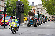 A group called 'Save British Farming' – representing farmers, consumers and members of the food production industry – are seen driving with their tractors, trucks and cars to Westminster in Central London, on Wednesday, July 8, 2020. VXP Photo/ Vudi Xhymshiti)