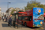 The southern French city of Marseille appears as an advert on the rear of a London tour bus travelling through the capital's streets, on Park Lane