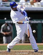 MESA, AZ - MARCH 6:  Marlon Byrd #24 of the Chicago Cubs bats against the Chicago White Sox on March 6, 2010 at HoHoKam Park in Mesa, Arizona. (Photo by Ron Vesely)