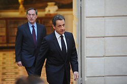 French President Nicolas Sarkozy flanked by Secretary-general of the Elysee Palace Claude Gueant arrives to give his New Year address to religious leaders during his traditional speech at Elysee Palace, in Paris, France on January 7, 2011. Photo by Mousse/ABACAPRESS.COM