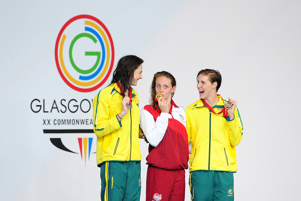 England's Francesca Halsall, centre, on the podium after winning women's 50m freestyle final.  Also pictured, silver medalist Cate Campbell, left, and bronze medalist Australia's Bronte Campbell<br /> <br /> Photographer Chris Vaughan/CameraSport<br /> <br /> 20th Commonwealth Games - Day 3 - Saturday 26th July 2014 - Swimming - Tollcross International Swimming Centre - Glasgow - UK<br /> <br /> © CameraSport - 43 Linden Ave. Countesthorpe. Leicester. England. LE8 5PG - Tel: +44 (0) 116 277 4147 - admin@camerasport.com - www.camerasport.com