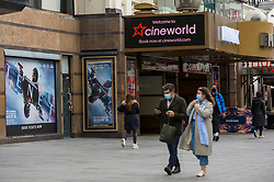 © Licensed to London News Pictures. 09/10/2020. LONDON, UK.  The exterior of the Cineworld cinema in Leicester Square.  The chain has recently announced the closing of 127 sites across the UK after the release date of the new James Bond film, No Time To Die, was delayed until spring 2021.  Property landlord AEW UK is pursuing legal action against Cineworld over £200,000 unpaid rents even though the chain has been forced to close cinemas due to the coronavirus pandemic and also as movie studios delay releases to the future.  It is reported that CVA (compulsory voluntary arrangements) may become likely.  Photo credit: Stephen Chung/LNP