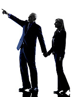 one caucasian couple senior pointing  silhouette  in silhouette studio isolated on white background