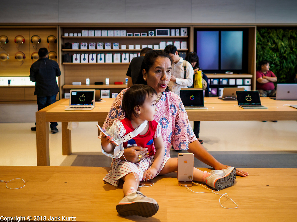 17 NOVEMBER 2018 - BANGKOK, THAILAND: People in the new Apple Store in ICONSIAM. ICONSIAM has the first Apple Store in Thailand. A second Apple Store is currently under construction in Central World, a mall in the center of Bangkok. ICONSIAM is a mixed-use development on the Thonburi side of the Chao Phraya River. It includes two large malls, with more than 520,000 square meters of retail space, an amusement park, two residential towers and a riverside park. It is the first large scale high end development on the Thonburi side of the river and will feature the first Apple Store in Thailand and the first Takashimaya department store in Thailand.      PHOTO BY JACK KURTZ