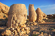 Image of the statues of around the tomb of Commagene King Antochus 1 on the top of Mount Nemrut, Turkey. Stock photos & Photo art prints. In 62 BC, King Antiochus I Theos of Commagene built on the mountain top a tomb-sanctuary flanked by huge statues (8–9 m/26–30 ft high) of himself, two lions, two eagles and various Greek, Armenian, and Iranian gods. The photos show the broken statues on the  2,134m (7,001ft)  mountain. 5 .<br /> <br /> If you prefer to buy from our ALAMY PHOTO LIBRARY  Collection visit : https://www.alamy.com/portfolio/paul-williams-funkystock/nemrutdagiancientstatues-turkey.html<br /> <br /> Visit our CLASSICAL WORLD HISTORIC SITES PHOTO COLLECTIONS for more photos to download or buy as wall art prints https://funkystock.photoshelter.com/gallery-collection/Classical-Era-Historic-Sites-Archaeological-Sites-Pictures-Images/C0000g4bSGiDL9rw