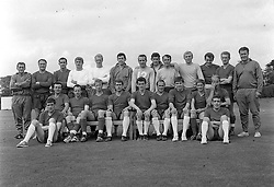 Shown here with their trainers are the 22 players in England's World Cup Squad. Left to right: Back row - Assistant trainer Les Cocker (Leeds United), George Cohen (Fulham), Gerry Byrne (Liverpool), Roger Hunt (Liverpool), Ron Flowers (Wolverhampton Wanderers), Gordon Banks (Leicester City), Ron Springett (Sheffield Wednesday), Peter Bonetti (Chelsea), Jimmy Greaves (Tottenham Hotspur), Bobby Moore (West Ham United), John Connelly (Manchester United), George Eastham (Arsenal) and Harold Shepherdson (Middlesbrough), trainer. Seated: Jimmy Armfield (Blackpool), Nobby Stiles (Manchester United), Jack Charlton (Leeds United), Geoff Hurst (West Ham United), Terry Paine (Southampton), Ray Wilson (Everton), Martin Peters (West Ham United), Alan Ball (Blackpool) and Bobby Charlton (Manchester United). Foreground: Norman Hunter (Leeds United), left, and Ian Callahan (Liverpool).